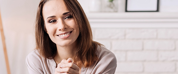 woman grinning in therapy